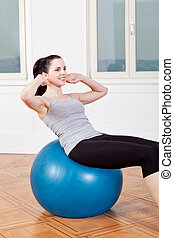 attractive young woman doing sit ups at home sport workout