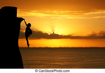 Mountain Climber - Girl climbing a tall mountain at sunset