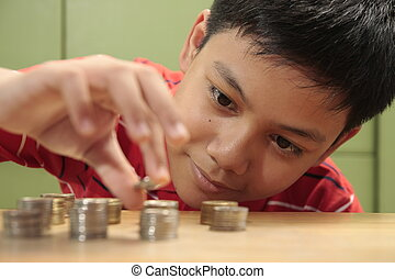 Boy and a Pile of Coins - A photo of a boy looking at a...