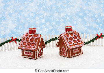 Merry Christmas - Two gingerbread houses and white picket...