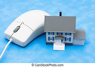 Online Real Estate - House sitting with computer mouse �...
