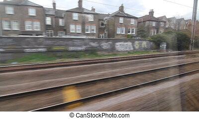 Train travel UK Past houses - Travelling by train and going...