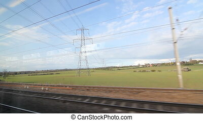 Train travel UK. Electrical Pylon. - Passing an electrical...