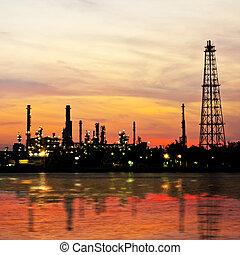Petroleum oil refinery factory over sunrise