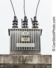 transformer on high power station - a power pole in white...