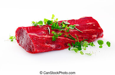 Healthy lean uncooked fillet steak garnished with fresh...