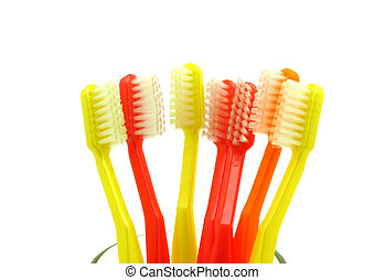 toothbrushes in a water glass