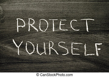 protect yourself phrase handwritten on school blackboard