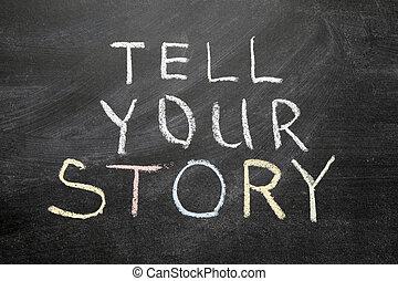 tell your story phrase handwritten on the school blackboard