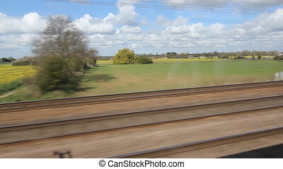 Britain by train Rapeseed - Travelling by train through the...