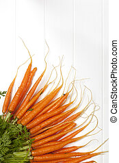 Bunch of Baby Carrots over White Timber