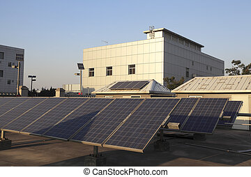 Buildings the roof using renewable solar power plant - Use...