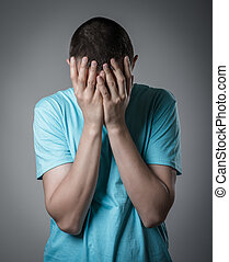 young man crying