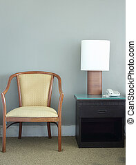 chair and table lamp in bedroom