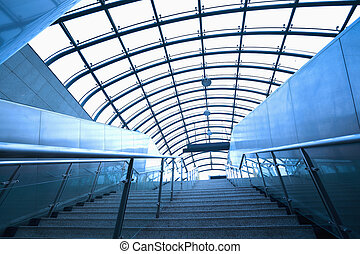 modern architecture steps of moving business escalator and...