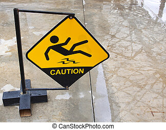 Yellow sign alerts for wet floor.