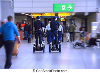 police by airport - mobile police in Amsterdam airport