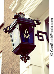 Freemason symbol on street lamp - city street lamp with...