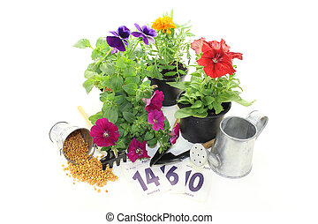slow-release Fertilizer in the bucket with flowers and...