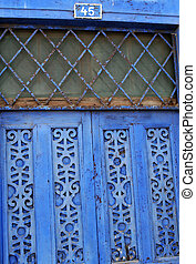 Blue Wooden Door - A blue door made of wood in South America