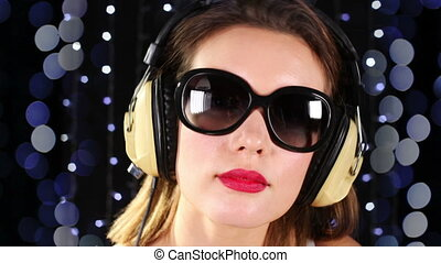 a sexy woman dances with headphones