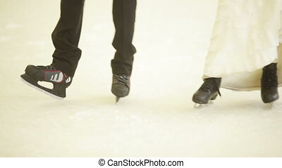 Young couple at the rink - Married couple is dancing in the...
