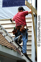 Home Owner Remodeling - Young home owner remodels his older...