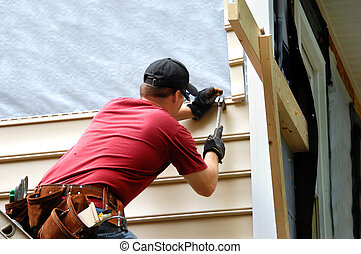 Do it yourselfer - Young homeowner installs siding to his...