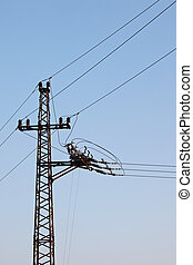 Electric line against clear blue sky