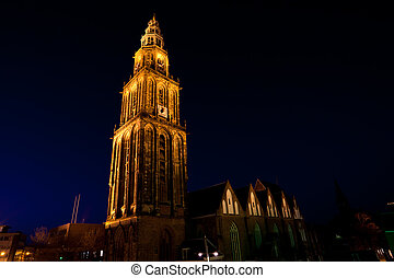 famous Martinitoren Martini tower in Groningen at night,...