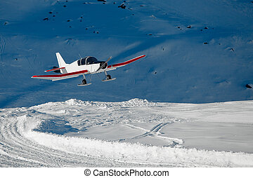 Snowplane landing in the mountains
