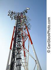 Transmitter - GSM transmitter tower against blue sky