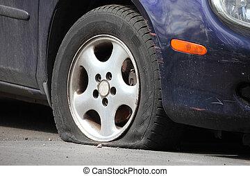 Flat Tire - Flat tire of a car