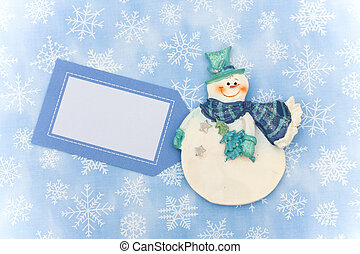 Merry Christmas - Snowman with blank gift tag on snowflake...