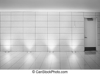 walls and door in an underground montreal metro corridor