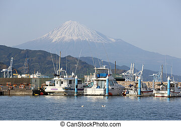 Motorboats at Shimizu port with mt. Fuji in background