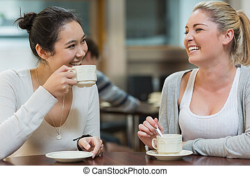 Two laughing students in college co - Two students having...