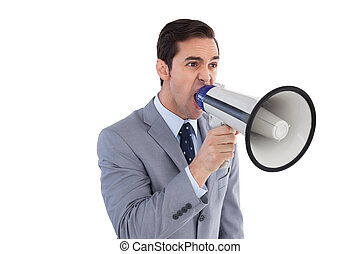 Businessman shouting into a megaphone on white background