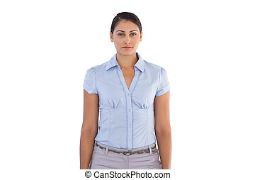 Young businesswoman standing alone on white background