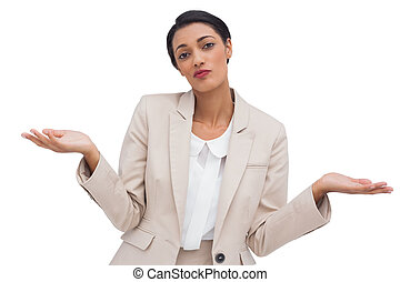 Confused attractive young businesswoman on white background