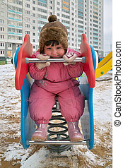 Dingle-dangle - Little girl plays outdoor and pose for...