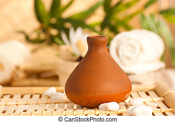 Clay jpot diffuser with essentail oils - Spa setting with...