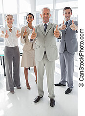 Group of business people giving thumbs up in the meeting...