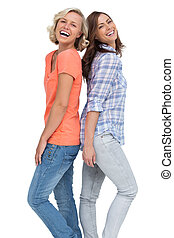 Two friends laughing back to back on white background