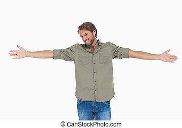 Man standing with arms outstretched on white background