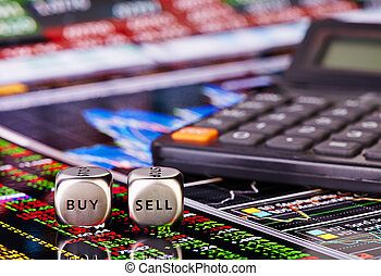 Dices cubes with words SELL BUY for trader and calculator. Financial chart and columns of figures as background. Selective focus