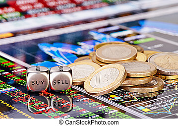 Dices cubes with the words SELL BUY, one-euro coins and a financial chart as the background. Selective focus