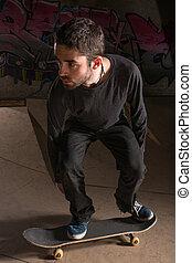 Skater bending his knees for balance