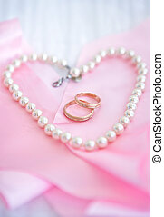Two wedding rings with pearl - Two wedding rings on the pink...