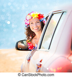 Summer car trip - Happy woman driver wearing hawaiian...